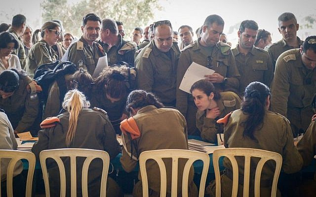 IDF soldiers from the Home Front Command seen during preparations before boarding a plane to aid in Nepal which suffered a massive earthquake, April 26, 2015. (photo credit: IDF Spokesperson)