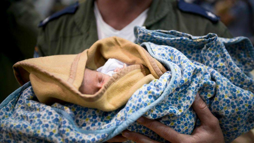 IDF aid delegation treats an infant in Nepal. (IDF Spokesperson)