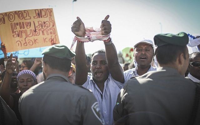 Hundreds of Israeli-Ethiopians protest outside the Police Headquarters in Jerusalem, against violence and racism directed at Israelis of Ethiopian descent, following a video clip released a few days ago showing police beating up an IDF soldier from the Ethiopian community. April 30, 2015. (photo credit: Hadas Parush/FLASH90)