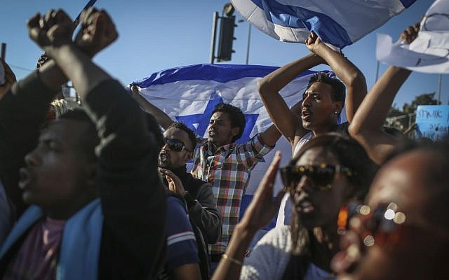 Demonstrators protest outside the National Police Headquarters in Jerusalem against violence and racism directed at Israelis of Ethiopian descent (photo credit: April 30, 2015. Photo by Hadas Parush/ FLASH90)