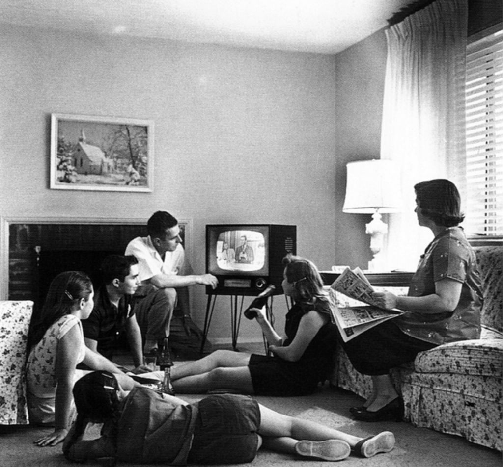 This 1958 scene of a family watching television could not have been photographed in Israel, as the Jewish state had no TV until 1966. (Wikimedia Commons/JTA)