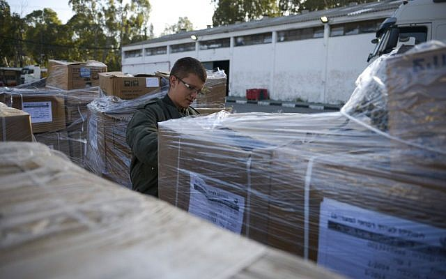 A soldier prepares equipment and supplies for the IDF's delegation to Nepal at the Tel Hashomer army base in Ramat Gan on April 26, 2015. (Photo credit: Gadi Yampel/IDF Spokesperson)