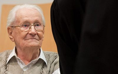 Defendant Oskar Groening sits in the dock of the court in Lueneburg, northern Germany, Tuesday, April 21, 2015. The 93-year-old former Auschwitz guard faces trial on 300,000 counts of accessory to murder, in a case that will test the argument that anyone who served at a Nazi death camp was complicit in what happened there. (photo credit: Julian Stratenschulte/Pool Photo via AP)