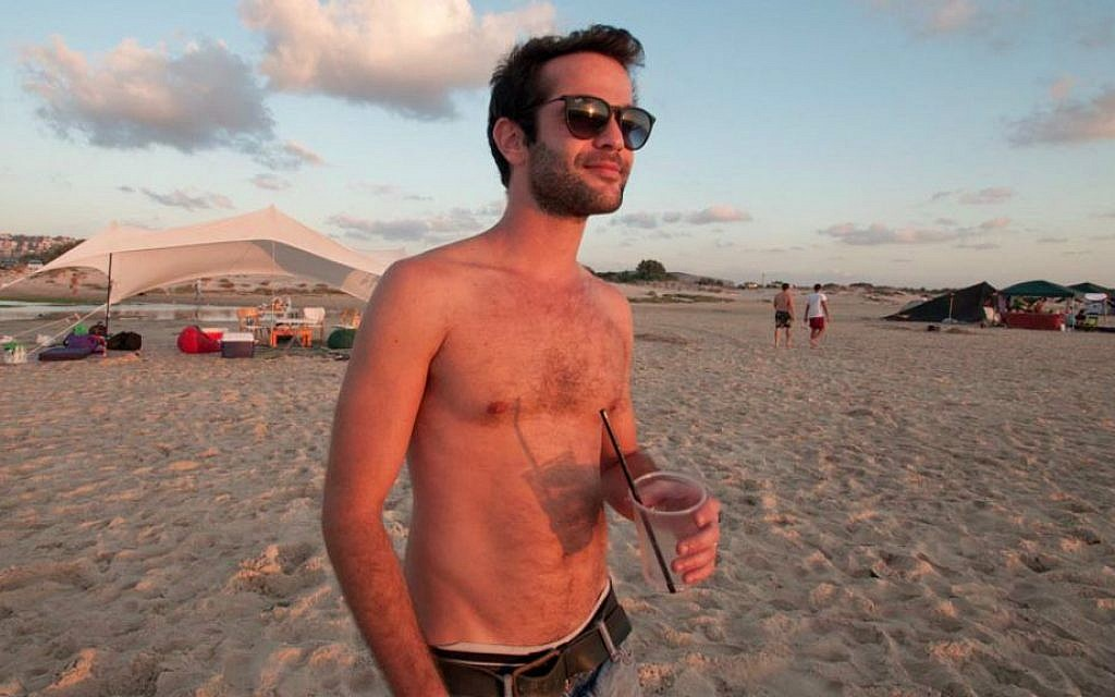 """Guy Trichter, 27, at Habonim Beach, lives in Tel Aviv: """"The 'country'... It's just some lines they drew on a map 80 years ago."""" (Photo credit: Judith Hertog)"""