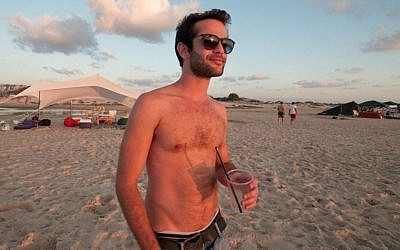 "Guy Trichter, 27, at Habonim Beach, lives in Tel Aviv: ""The 'country'... It's just some lines they drew on a map 80 years ago."" (Photo credit: Judith Hertog)"