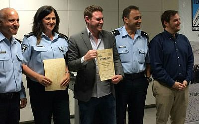 TLV Internationals' Jonathan Javor (center) participated in the the Civil Guard training course for new immigrants, which he initiated. (photo credit: Renee Ghert-Zand/Times of Israel staff)