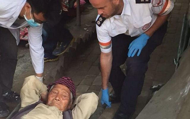 Ravit Martinez and Ilan Klein, paramedics from Magen David Adom, assist local residents in Kathmandu, April 25, 2015. (photo credit: Courtesy MDA)