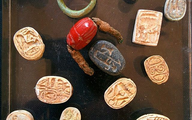 File: 18th Dynasty scarab seals and a carnelian signet ring found by IAA archaeologists in a cave near Tel Halif, in southern Israel (photo credit: Ilan Ben Zion/Times of Israel staff)