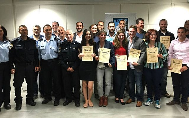 Fifteen new immigrants receive certificates upon completing their Civil Guard basic training, Tel Aviv, April 16, 2015. (photo credit: courtesy)