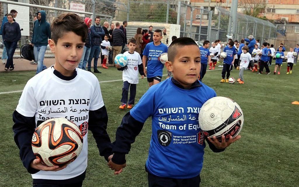 Arab and Jewish children living in Jerusalem practice soccer through the 'Team of Equals' initiative, March 19, 2015 (photo credit: courtesy/Yossi Zamir)