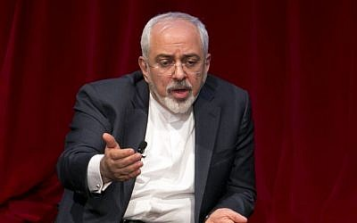 Iran's Foreign Minister Mohammad Javad Zarif is interviewed by David Ignatius of the Washington Post, during his appearance, hosted by the Center on International Cooperation, at New York University, Wednesday, April 29, 2015. (Photo credit: AP/Richard Drew)