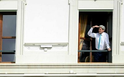 In this April 1, 2015, photo US Secretary of State John Kerry looks at the view of Lake Geneva from his hotel room as the Iran nuclear talks continue in Lausanne, Switzerland. (AP Photo/Keystone, Laurent Gillieron, file)