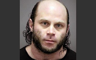 In the Feb. 2, 2014 photo provided by the Rock County, Wisconsin, Sheriff's Office is Joshua Van Haften, 34, of Madison, Wisconsin. Van Haften was arrested Wednesday, April 8, 2015 at O'Hare International Airport in Chicago after returning on a flight from Turkey. (photo credit: Rock County Sheriff's Office via AP)