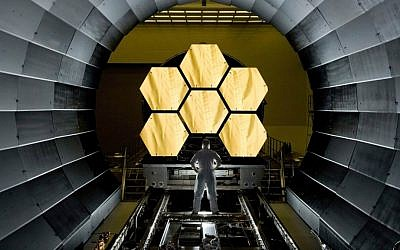 NASA engineer Ernie Wright looks on as the first six flight ready James Webb Space Telescope's primary mirror segments are prepped to begin final cryogenic testing at NASA's Marshall Space Flight Center. (NASA/MSFC/David Higginbotham/Wikipedia)