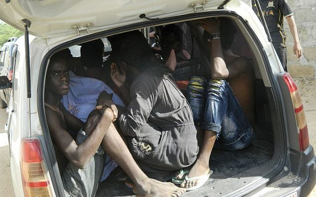 Students of the Garissa University College take shelter in a vehicle after fleeing from an attack by gunmen in Garissa, Kenya, Thursday, April 2, 2015.  (photo credit: AP Photo)
