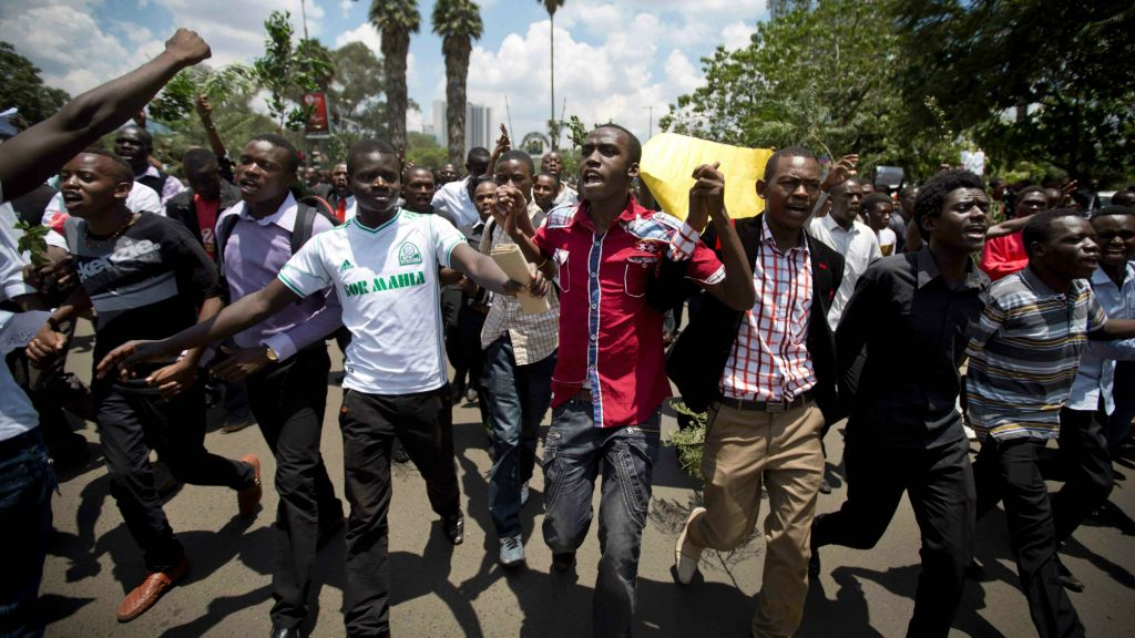 Kenyan students march in memory of the victims of the Garissa college attack and to protest what they say is a lack of security, in downtown Nairobi, Kenya, Tuesday, April 7, 2015. (AP Photo/Ben Curtis)