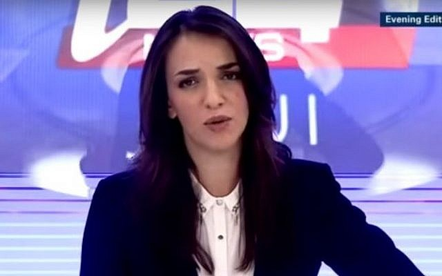 Lucy Aharish hosts the evening edition on i24news photo credit: YouTube image