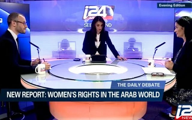 Israeli journalist Lucy Aharish moderates a debate on i24 News. (YouTube image)
