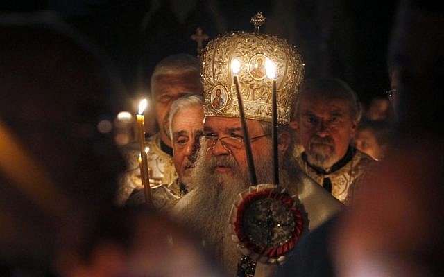 With candles, prayers, Orthodox Christians mark Easter | The