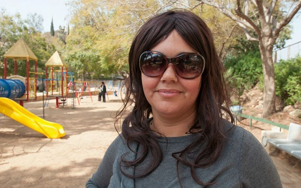 """Maya, 42, at Akiva Gur Garden, Bnei Brak, lives in Bnei Brak: """"For me, the hardest part of becoming religious was the clothing."""" (Photo credit: Judith Hertog)"""