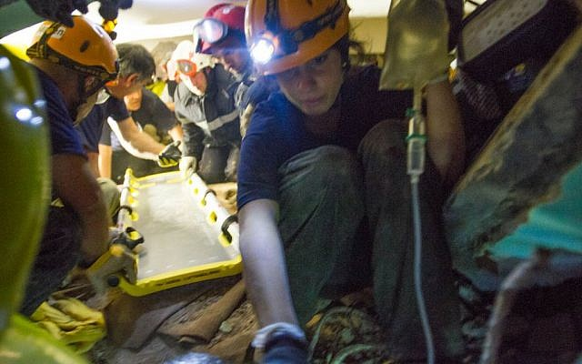 An Israeli-led team of rescuers works to extract a Nepalese woman from under the rubble of a collapsed hotel in Kathmandu on Thursday, April 30, 2015 (photo credit: IsraAID/Mickey Noam Alon)