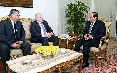In this image provided by the office of the Egyptian Presidency, Egyptian President Abdel-Fattah el-Sissi, right, meets with CIA director John Brennan, center, and the director of Egypt's General Intelligence Directorate Khaled Fawzy in Cairo, Sunday, April 19, 2015. (Egyptian Presidency via AP)