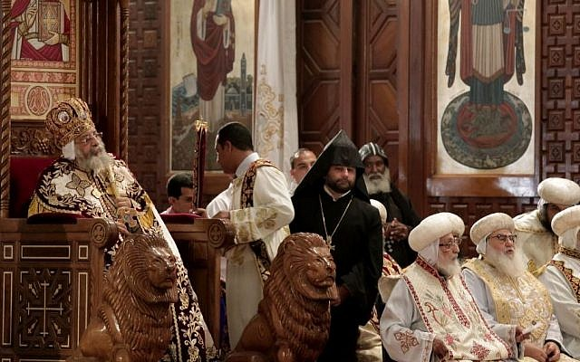 Coptic Pope Tawadros II, left, sits on the throne of Mar Morqos, during the Easter Eve service at St. Mark's Cathedral, in Cairo, Egypt, April 11, 2015. (photo credit: AP/Nariman El-Mofty)