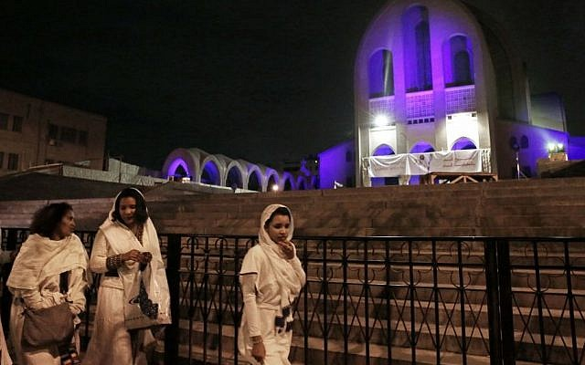 Ethiopian Christian women walk during the Easter Eve service at St. Mark's Cathedral, in Cairo, Egypt, April 11, 2015. (photo credit: AP/Nariman El-Mofty)