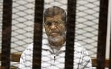 Egypt's ousted Islamist president Mohammed Morsi in a defendant cage in the Police Academy courthouse, May 8, 2014, in Cairo, Egypt. (Tarek el-Gabbas/AP/File)