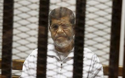 File photo showing Egypt's ousted Islamist president Mohammed Morsi in a defendant cage in the Police Academy courthouse, May 8, 2014  Cairo, Egypt. (Tarek el-Gabbas/AP)