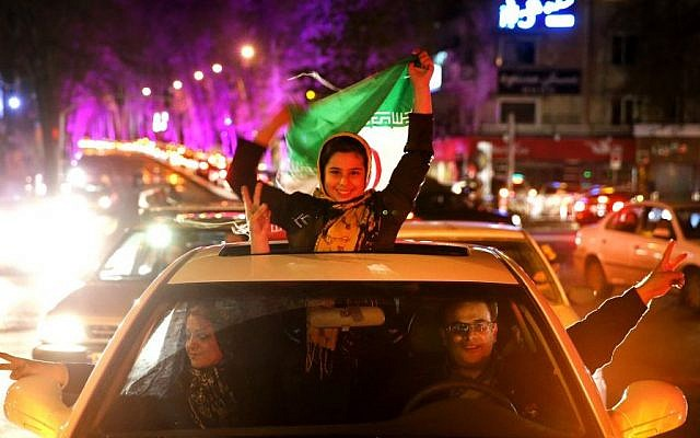 Iranians celebrate in Tehran after Iran's nuclear agreement with world powers in Lausanne, Switzerland, April 2, 2015. (photo credit: AP/Ebrahim Noroozi)