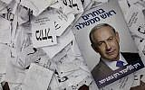 This March 18, 2015, photo, shows a Prime Minister Benjamin Netanyahu election campaign poster lying among ballot papers at his party's election headquarters in Tel Aviv. (AP/Dan Balilty)