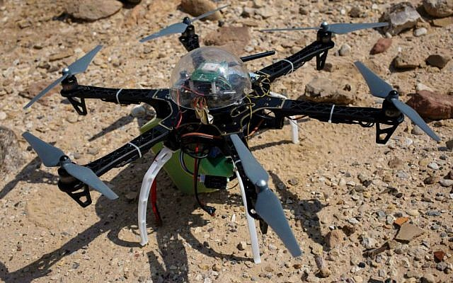In this photo taken Thursday, March 19, 2015, a six-bladed drone casts a shadow on a heavily looted 5,000-year-old cemetery, known as Fifa, in southern Jordan. (AP Photo/Sam McNeil)