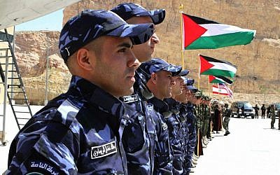 Members of the Palestinian special police forces (S.P.F) wait to compete during the 7th Annual International Warrior Competition hosted by the King Abdullah Special Operations Training Center (KASOTC), Sunday, April 19, 2015, Amman, Jordan. (AP Photo/Raad Adayleh)
