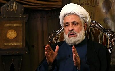 The deputy chief of Hezbollah, Sheikh Naim Kassem, speaks during an interview with the Associated Press, in the Shiite group's stronghold in Beirut, Lebanon, on April 13, 2015. (photo credit: AP/Hussein Malla)