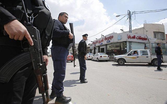 Palestinian police patrol in the West Bank town of Azariyeh, April 13, 2015. (photo credit: AP/Nasser Shiyoukhi)