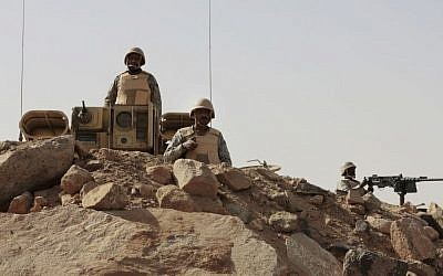 Saudi soldiers stand on top of armored vehicles, on the border with Yemen at a military point in Najran, Saudi Arabia, Tuesday, April 21, 2015. (AP/Hasan Jamali)