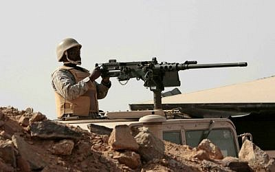 A Saudi soldier sits atop an armored vehicle on the border with Yemen, at a military post in Najran, Saudi Arabia, Tuesday, April 21, 2015. (AP Photo/Hasan Jamali)