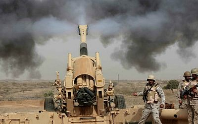 Saudi soldiers fire artillery toward three armed vehicles approaching the Saudi border with Yemen in Jazan, Saudi Arabia, Monday, April 20, 2015. (AP Photo/Hasan Jamali)