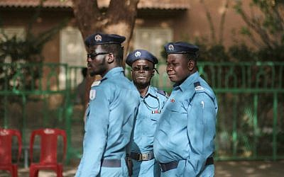 Sudanese security forces work at a polling station on the first day of presidential and legislative elections in Khartoum, Sudan, Monday, April 13, 2015. (AP Photo/Mosa'ab Elshamy)