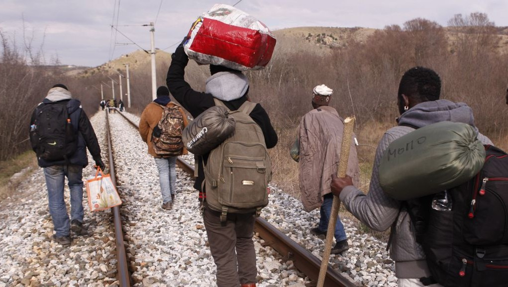 West African migrants walk on train tracks on their way towards the border with Macedonia near the town of Evzonoi, Greece, Feb. 28, 2015 (photo credit: AP/Dalton Bennett)