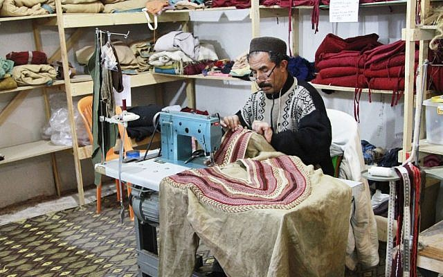 "In this photo dated Jan. 30, 2015 a tailor sews costumes for the TV series ""A.D."" in the city of Ouarzazate, Morocco not far from where it's being filmed. (photo credit: AP Photo/ Paul Schemm)"