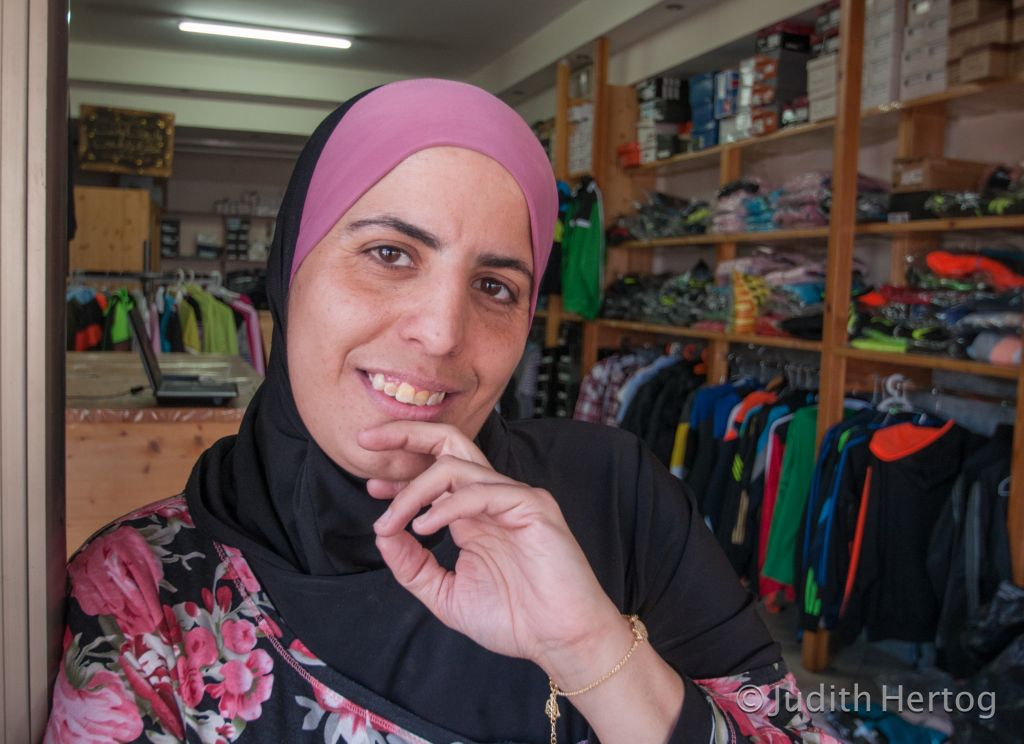 """Nada Mansoor, 33, on Jaffa Road in Tira, where she lives: """"Believe me! I've done things a man can't do!"""" (Photo credit: Judith Hertog)"""