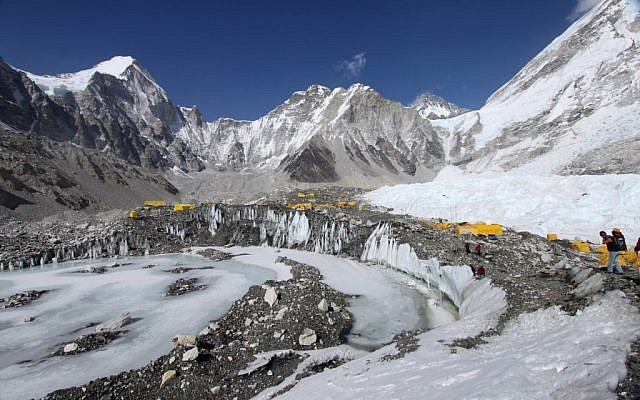 Tents are seen set up for climbers on the Khumbu Glacier, with Mount Khumbutse, center, and Khumbu Icefall, right, seen in background, at Everest Base Camp in Nepal on April 11, 2015. An avalanche triggered by a massive earthquake in Nepal smashed into a base camp between the Khumbu Icefall, a notoriously treacherous rugged area of collapsed ice and snow, and the base camp where most climbing expeditions are, said Ang Tshering of the Nepal Mountaineering Association. (photo credit: AP Photo/Tashi Sherpa, File)
