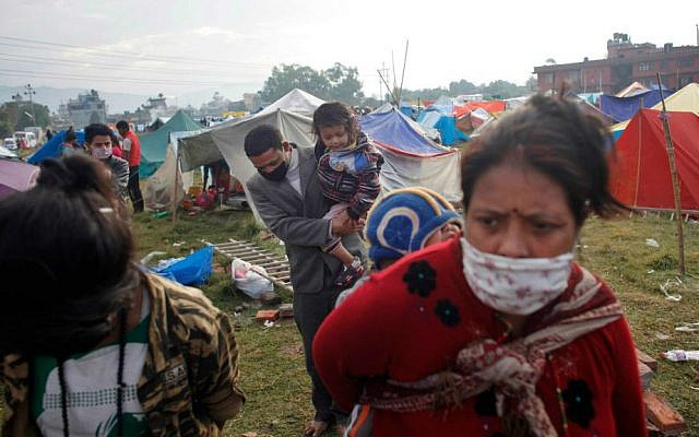Nepalese people prepare to go back home after sleeping on open grounds for four nights to be safe from earthquake in Kathmandu, Nepal, Wednesday, April 29, 2015. (AP Photo/Niranjan Shrestha)