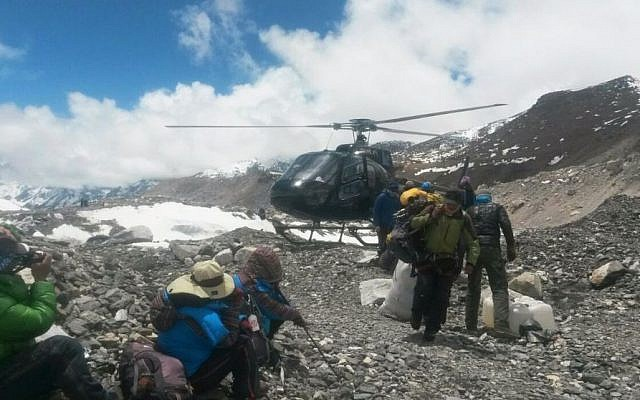 A rescue chopper lands carrying people from higher camps to Everest Base Camp, Nepal, Monday, April 27, 2015. (photo credit: AP/Nima Namgyal Sherpa)