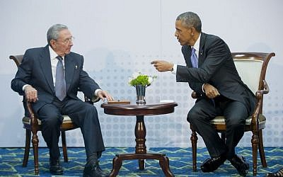 US President Barack Obama, right, leans over towards Cuban President Raul Castro during their meeting at the Summit of the Americas in Panama City, Panama, Saturday, April 11, 2015. (AP Photo/Pablo Martinez Monsivais)