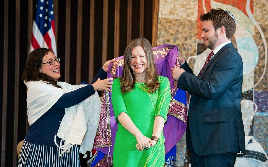 Newly ordained rabbis Ilanit Goldberg, left, and Nicholas Renner drape a tallit over Malka Packer during her ordination ceremony at the Reconstructionist Rabbinical College's 2014 commencement. (Courtesy of RRC/Jewish Reconstructionist Communities/JTA)
