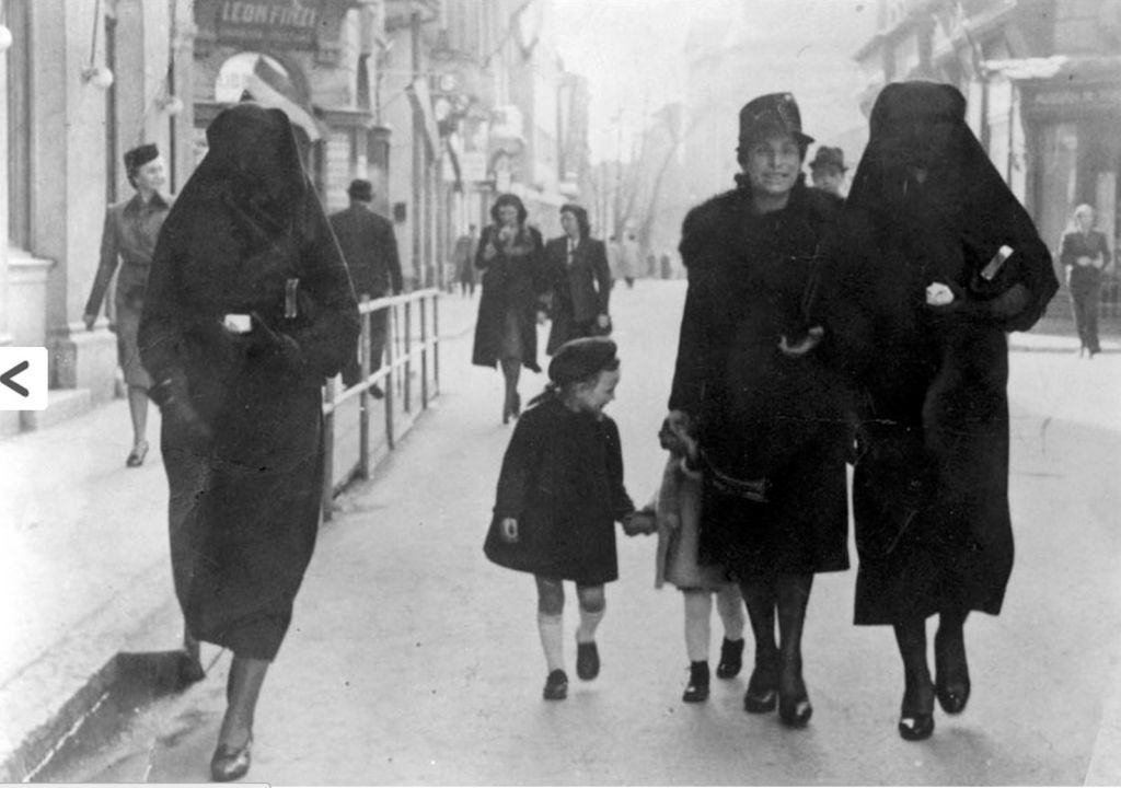 Muslim Righteous Among the Nations Zejneba Hardaga (far right) on the streets of Sarajevo. (courtesy Yad Vashem)