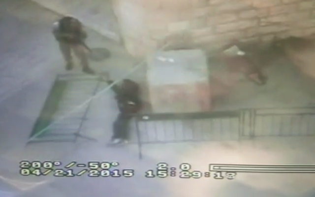 Screen capture from footage of what police said was a Palestinian man stabbing a Border Police officer in Hebron on Saturday, April 25, 2015. (screen capture: Israel Police video)